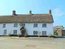 Charming Double Fronted Thatched Cottage